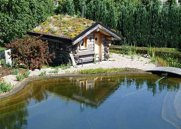 Kelo Massivholzsauna am Teich